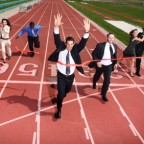 Business people crossing finish line