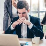Businessman contemplates business development strategy going through growing pains of changing approach in client engagement